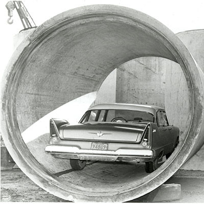a Car is shown in one of the sewer pipes prior to installation